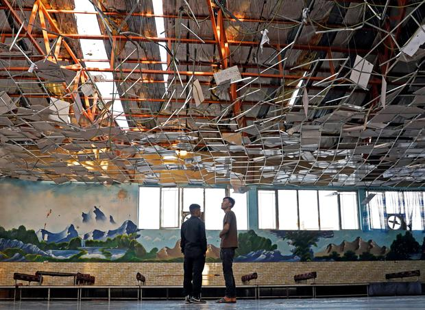 Workers inspect a damaged wedding hall after a blast in Kabul, Afghanistan REUTERS/Mohammad Ismail