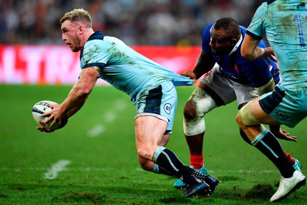 Scotland's full back Stuart Hogg (L) is tackled by France's prop Jefferson Poirot (R) during the 2019 Rugby World Cup warm-up test match between France and Scotland, at the Allianz Riviera stadium, in Nice, on August 17, 2019. (Photo by Pascal GUYOT / AFP)PASCAL GUYOT/AFP/Getty Images