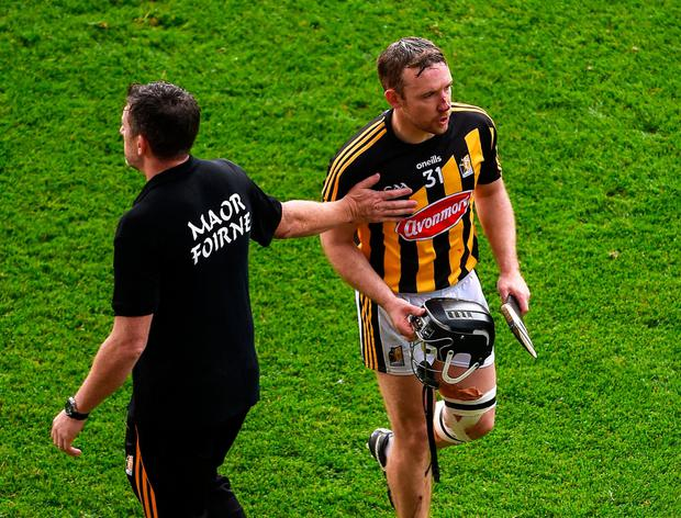 Selector Derek Lyng consoles Richie Hogan after he was sent off