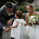 Kathyn Thomas, new husband Padraig McLaughlin and their daughter Ellie