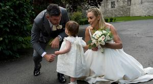 Kathryn Thomas, new husband Padraig McLaughlin and their daughter Ellie