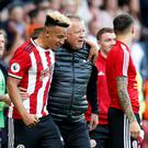 Sheffield United manager Chris Wilder celebrates with Callum Robinson after the match