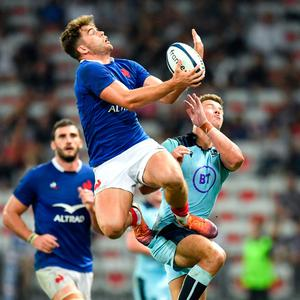 France's wing Damian Penaud fights for the ball against Scotland's centre Huw Jones. Photo: Getty Images
