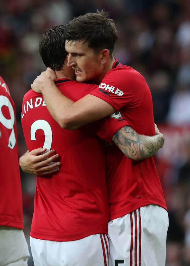 Harry Maguire and Victor Lindelof celebrate after Manchester United's opening day victory against Chelsea. Photo: Getty Images