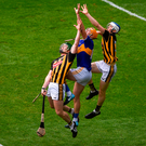 Tipperary's Séamus Callanan in an aerial battle with Kilkenny duo Paul Murphy and Huw Lawlor. Photo: Sportsfile