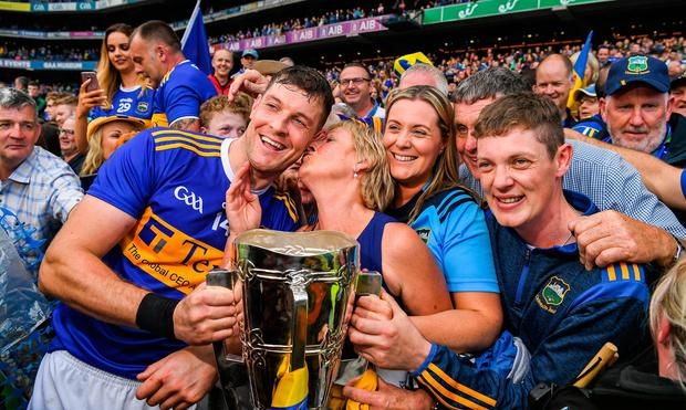 Tipperary captain Séamus Callanan is congratulated by his mother Mary and dad John, sister Fiona, and his brother John