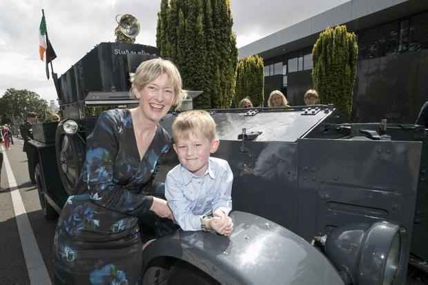 Family pride: Geraldine Dalton, Michael Collins's great grandniece, and son Joseph with the Sliabh na mBan armoured car. Photo: Iain White/Fennell Photography