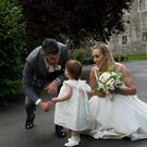 White wedding: Kathyn Thomas and husband Pádraig McLoughlin with daughter Ellie. Photo: Shane O'Neill