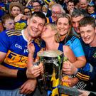 A mother's pride: Tipperary captain Séamus Callanan is congratulated by his mother Mary and father John, sister Fiona, and his brother John. Photo: Stephen McCarthy/Sportsfile