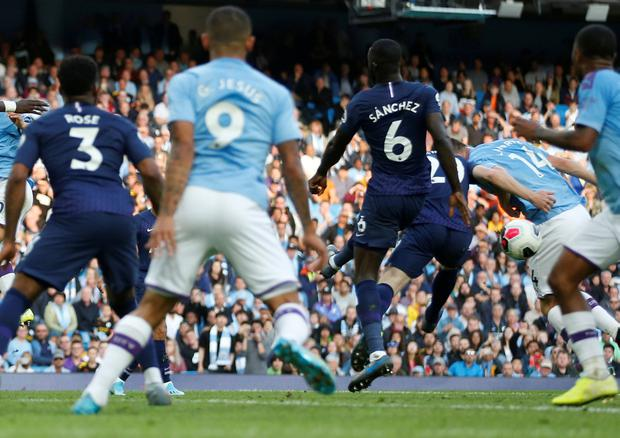 The ball hits Aymeric Laporte's hand resulting in Manchester City's late winner by Gabriel Jesus being disallowed. Photo: Reuters/Carl Recine
