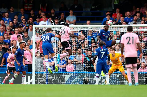 Leicester City's Wilfred Ndidi rises highest to score the equaliser against Chelsea. Photo by Catherine Ivill/Getty Images