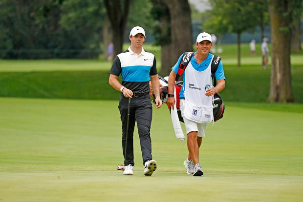 Rory McIlroy and his caddie walk the 11th hole during the third round of the BMW Championship golf tournament at Medinah Country Club - No. 3. Mandatory Credit: Brian Spurlock-USA TODAY Sports