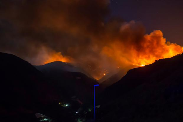 Flames and smoke from a forest fire are seen in the village of Ingenio, in Gran Canaria, Canary Islands. Pic: Reuters