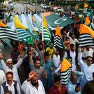 Protest: Marchers in Karachi, Pakistan, wave Kashmir flags. Photo: Getty Images