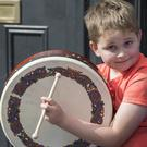 Mark Flood (7), from Longford, on the bodhrán. Photo: Arthur Carron