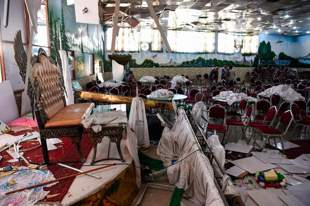 Destruction: The wedding hall in Kabul after the suicide bomber struck. Photo: Getty Images