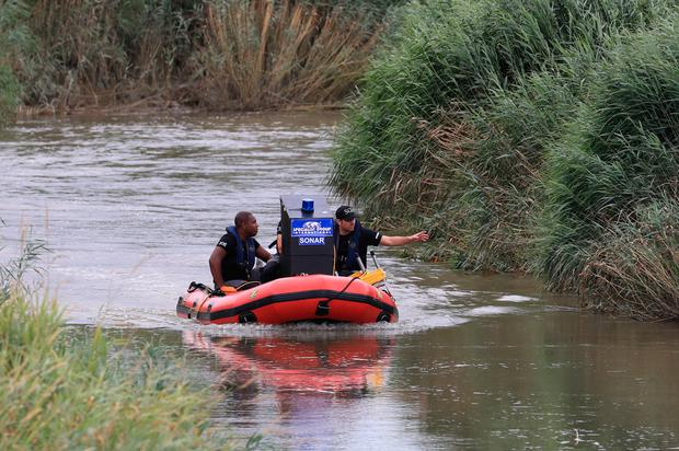 A specialist search team search a section of the River Stour for missing six-year-old Lucas Dobson Photo credit: Gareth Fuller/PA Wire