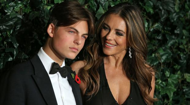 British actress Elizabeth Hurley (R) and her son Damian pose on the red carpet as they attend the 62nd London Evening Standard Theatre Awards 2016 in London