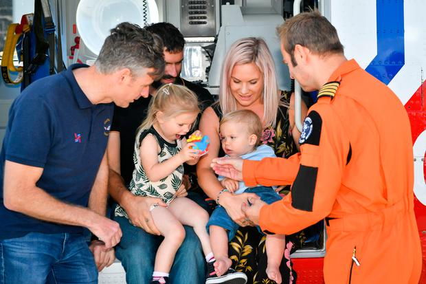 Alicia and Sandy MacDonald with baby Torran, as they celebrate his first birthday with the Bristow Search and Rescue Team at the HM Coastguard helicopter base Photo credit: Ben Birchall/PA Wire