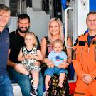 Pictured are Pilot Paul Forbes (left), dad Sandy, Fearne, Torran, mum Alicia and Pilot Yogi Brunner (right) Photo credit: Ben Birchall/PA Wire