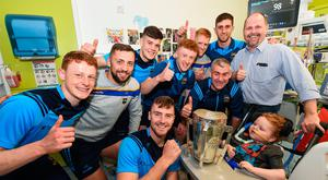 Charlie Aabo, and his son Kian Barnes-Aabo, aged 5, from Glanmire, Co. Cork, are shown the Liam MacCarthy cup by Tipperary manager Liam Sheedy and Tipperary players