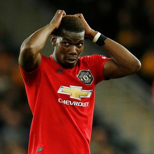 Manchester United's Paul Pogba reacts after his penalty is saved by Wolverhampton Wanderers' Rui Patricio