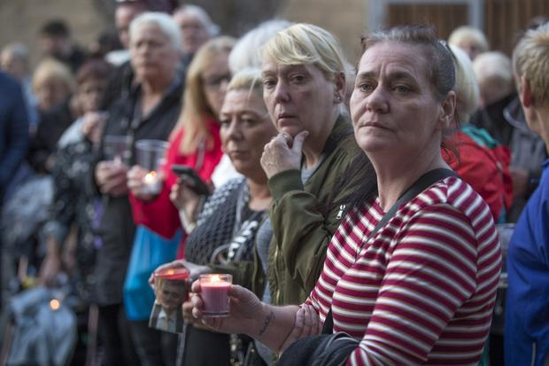 Local residents attend a candle light vigil neld for pensioner Paddy Hansard who was seriously injured following an attack at the Courtney Place flat complex at the weekend. Picture: Arthur Carron
