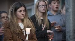 Support: Locals attend a candle light vigil for Paddy Hansard who was seriously injured following an attack. Photo: Arthur Carron