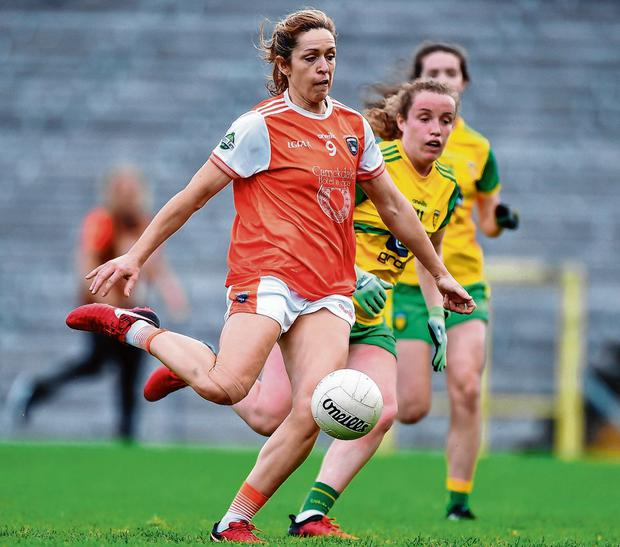 Caroline O'Hanlon, here finding the net for Armagh against Donegal in the Ulster final, says it's up to the rest of the teams to match the standards set by Dublin and Cork. Photo: Ben McShane/Sportsfile