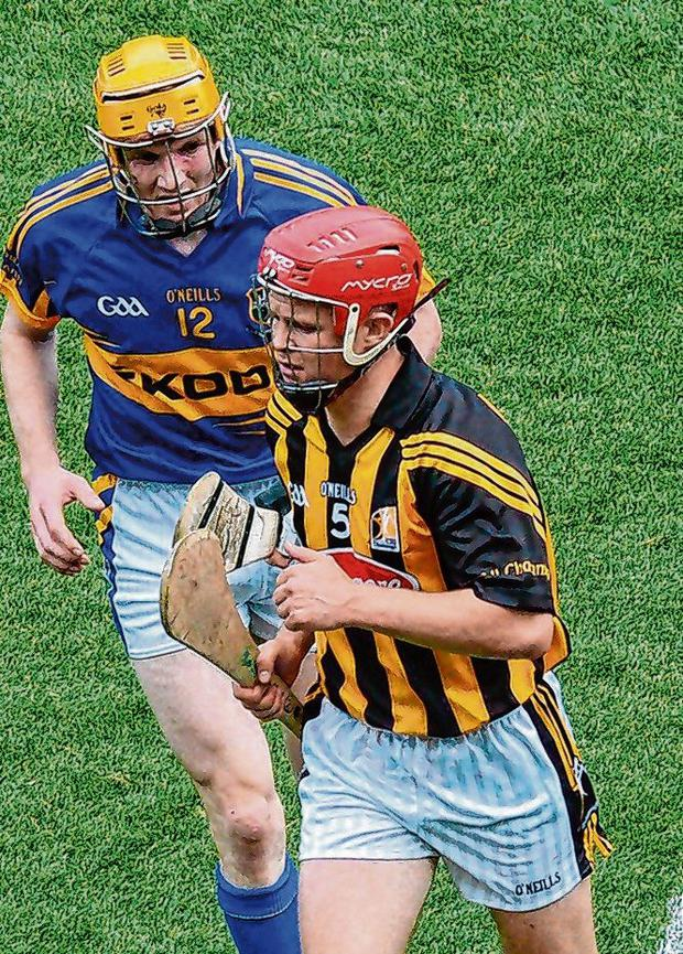 Lar Corbett tracking Tommy Walsh during the controversial 2012 All-Ireland semi-final defeat to Kilkenny. Photo: Brendan Moran / Sportsfile