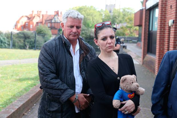 Jo, the mother of Jed Foster, with his stepfather outside Reading Magistrates Court w Photo credit: Steve Parsons/PA Wire