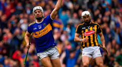 Tipperary forward Niall O'Meara wheels away in delight from a disconsolate Conor Fogarty of Kilkenny after scoring his side's first goal on Sunday. Photo: Sportsfile