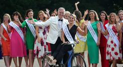 Blooming Roses: Rose of Tralee host Dáithí Ó Sé greets Melbourne Rose Jordan Balfry and some of the other contestants at Castletown House, Celbridge, Co Kildare, yesterday. Photo: Collins