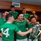 Limerick celebrate All-Ireland glory last year and (right) Graeme Mulcahy dejected after defeat to Kilkenny