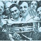 Kevin Heffernan, captain of the Dublin team, with the Sam Maguire Cup after the 1958 final. Dr. Stuart, President of the GAA, is on the left beside Marcus Wilson of the Dublin team