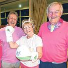Tickled pink: Hermitage Golf Club Lady Captain Maefil McDermot with the Katie Taylor signed boxing gloves. Also in the picture (from left) Maria Duffy and Mark Kelly and Hermitage Captain Jimmy Doyle. Picture: Pat Cashman