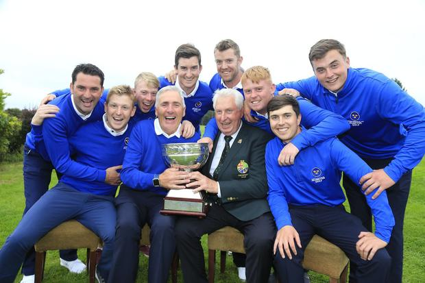 That winning feeling: GUI President John Moloughney presents the 2018 Interpro Championship trophy to Michael Coote and the Munster team at Athenry Golf Club. Photo: Fran Caffrey