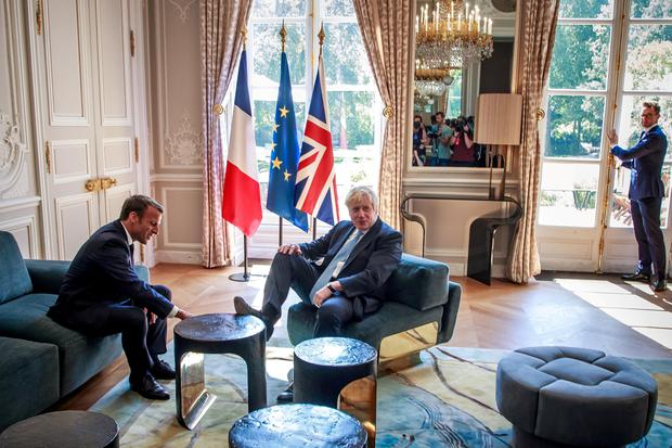 French President Emmanuel Macron and British Prime Minister Boris Johnson speak during a meeting at the Elysee Palace in Paris. Picture: Christophe Petit Tesson/Pool via REUTERS/File Photo
