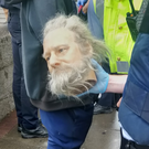 One of the waxwork heads is carried by a garda