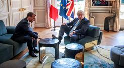 Putting his foot in it: French President Emmanuel Macron and British Prime Minister Boris Johnson at the Elysée Palace in Paris. Photo: Christophe Petit Tesson
