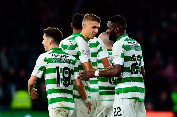 Celtic celebrate with Odsonne Edouard after he scored their second goal. Photo: Mark Runnacles/Getty Images