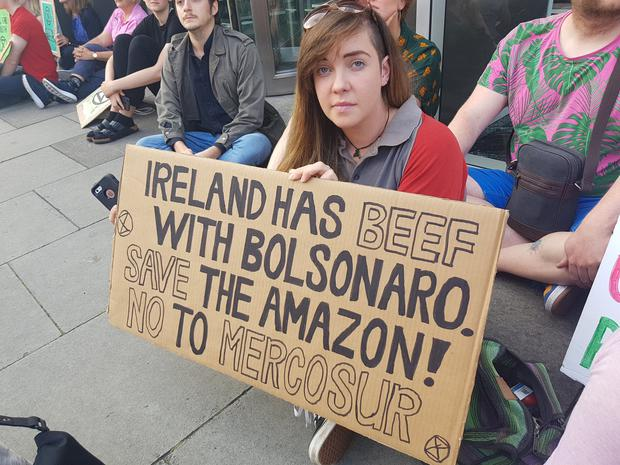 A protester holds a banner at today's protest.