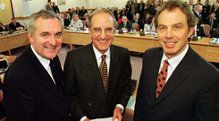 History: Bertie Ahern, George Mitchell and Tony Blair after signing the Good Friday Agreement. Photo: Photocall Ireland