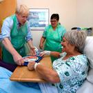 Boris on manoeuvres: British Prime Minister Boris Johnson serves food to a patient during a visit to a hospital in Devon, south west England. Photo: PA