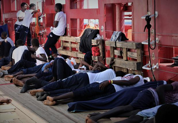 Rescued migrants rest aboard the Ocean Viking, run by French charities Medecins Sans Frontieres and SOS Mediterranee