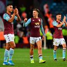 Aston Villa's Dutch striker Anwar El Ghazi (l), midfielder Jack Grealish (c) and midfielder John McGinn (r) celebrate at the end of the Premier League win over Everton at Villa Park in Birmingham