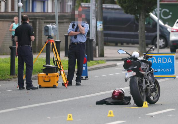 Gardai examine the scene of the fatal accident. Photo: Colin Keegan, Collins Dublin