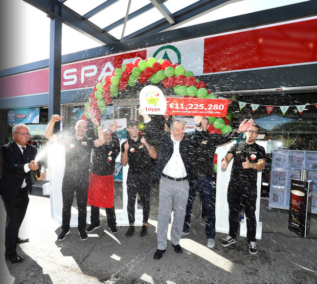 Ken O'Connor, owner of the Spar Service Station, celebrates with staff