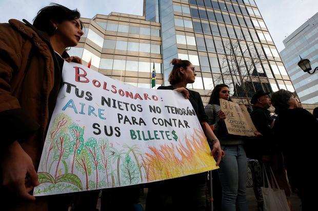 Demonstrators of environmental organizations take part in a rally in front of the embassy of Brazil in demand to more Amazon protection in Santiago, Chile August 23, 2019. REUTERS/Rodrigo Garrido