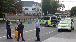 Gardai examine the scene of a fatal collision between a motorcycle and a male pedestrian on the Malahide Road .Picture Colin Keegan, Collins Dublin